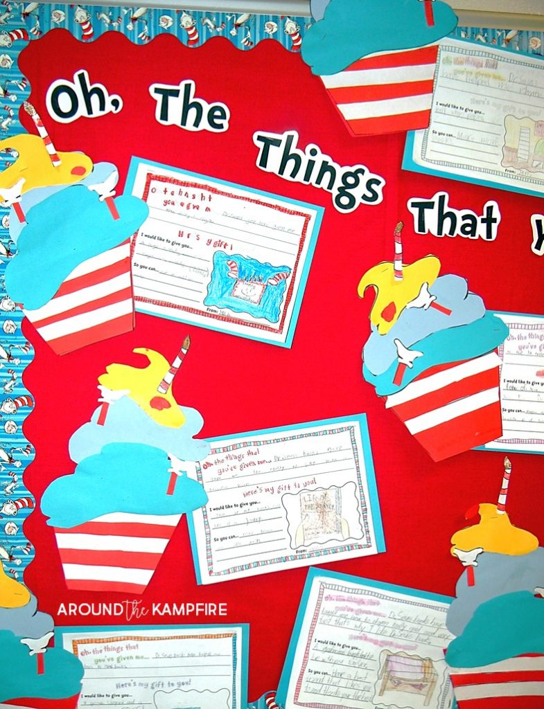 """Literacy Week bulletin board idea- We """"baked"""" Seuss style birthday cupcakes and wrote about what Dr. Seuss has given us then gave a gift to him."""