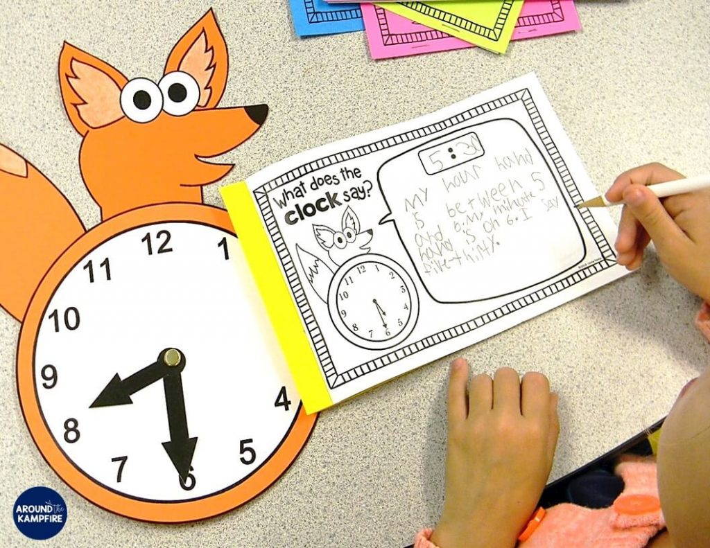 "This ""What does the clock say?"" telling time craft gets kids writing about math and doubles as a practice clock. The fun, hands-on ideas and telling time activities in this post are for first, second, and even third graders and make teaching kids to tell time easy and fun! Be sure to download the free telling time game too!"