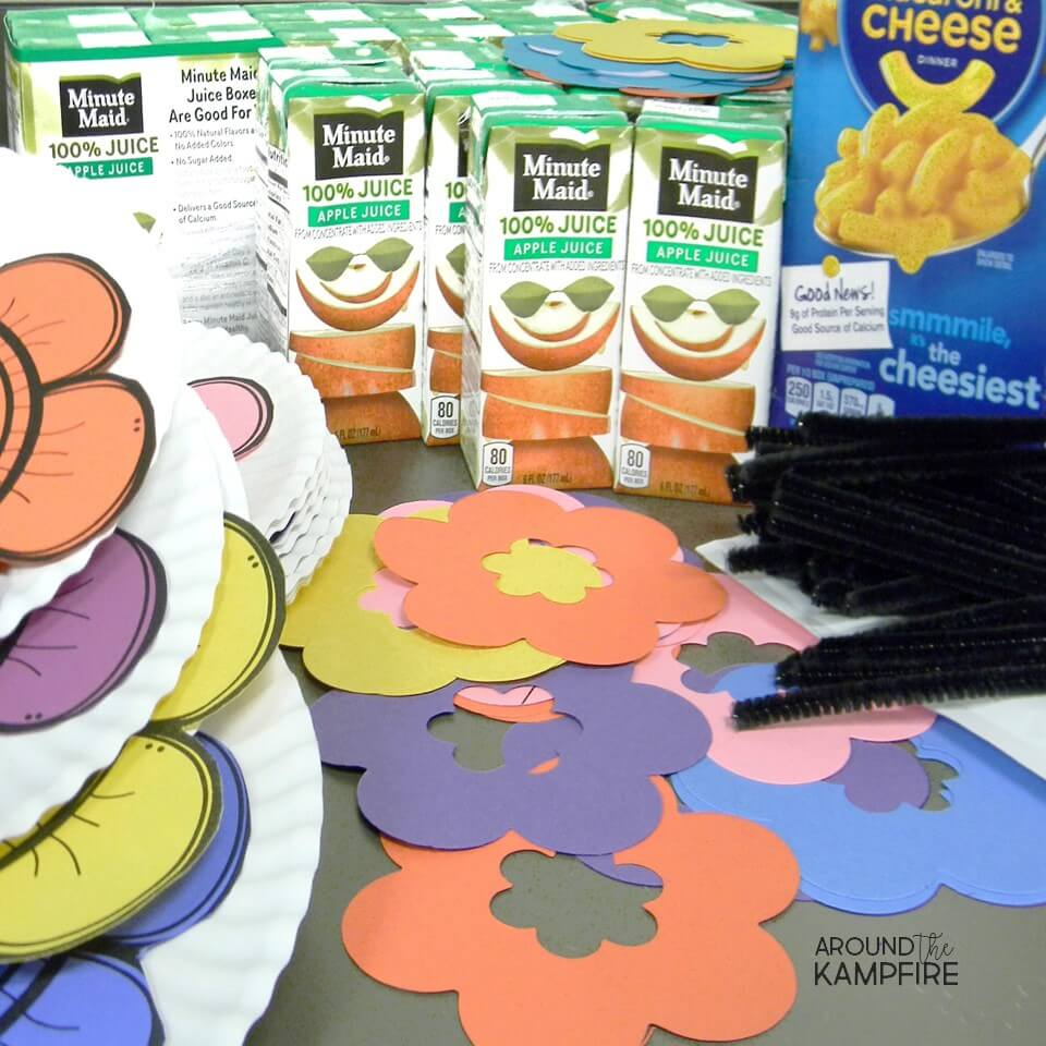 Pollination science activity student supplies-macaroni and cheese powder, juice box, and pipe cleaners.