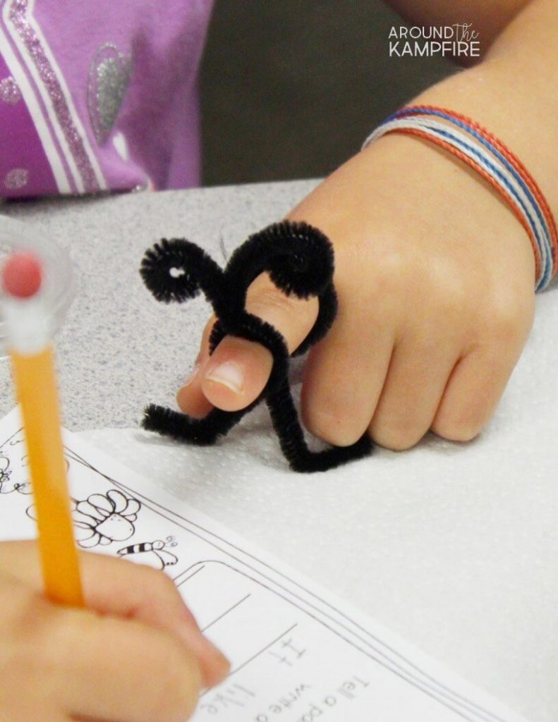 Pollination science activity for kids-Pipe cleaner butterfly feet and antennae.