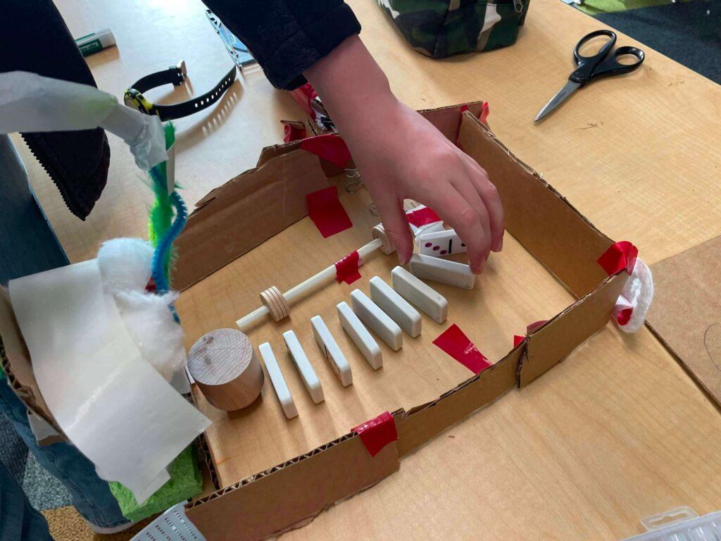Rube Goldberg chain reaction machine